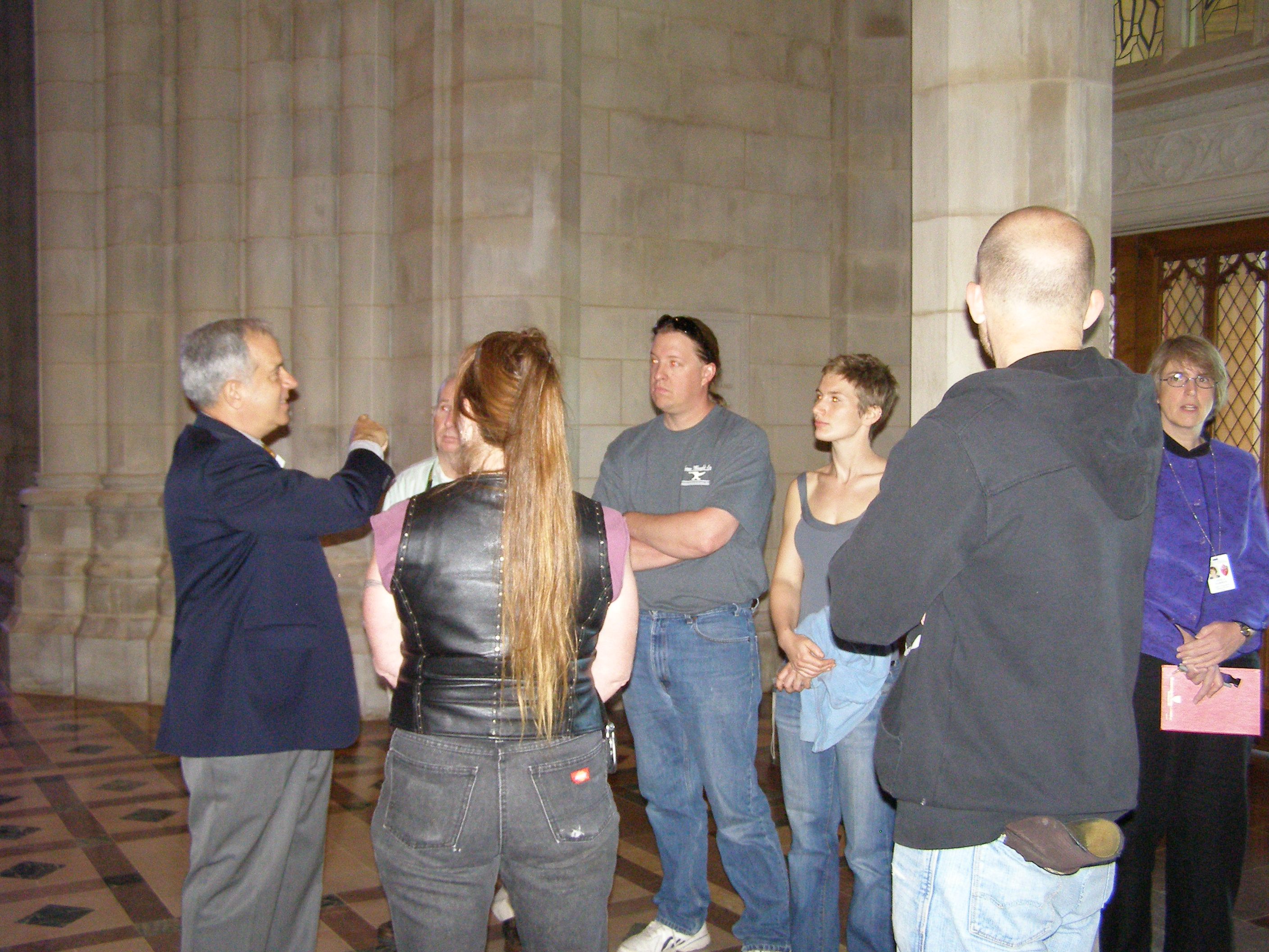 Docent Barry Bem Talking to Tour Group at West Entrance to Nave